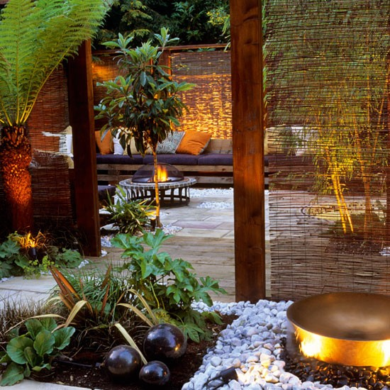 Exotic garden with fire pit, willow screens and decking