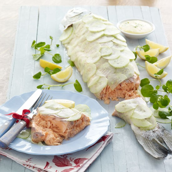 Roasting a whole salmon feels extravagant but works out cheaper if you're feeding a crowd. Serve with lemon wedges, watercress leaves and chive-flecked mayonnaise.