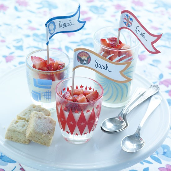 A traditional English cream and sugar-based dessert topped with a spoonful of fresh strawberry compote — summer in a pot.