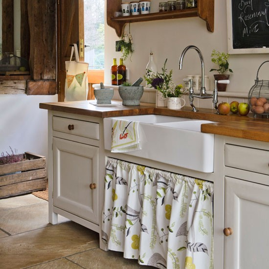 vintage kitchen with old fashioned porcelain sink lace curtains sink