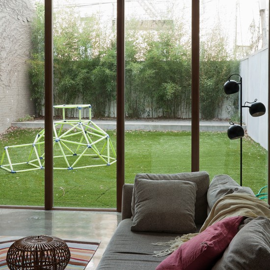 Living area with double-height windows | Modern design | Livingetc | Housetohome