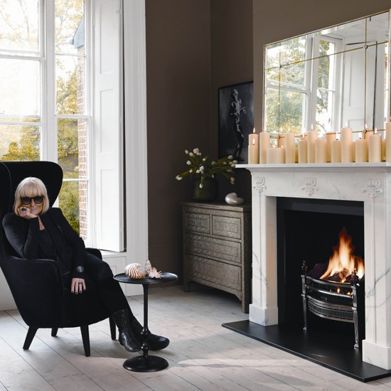Biba founder Barbara Hulanicki basks in the glow of her Art Nouveau fireplace for Chesney's of London