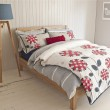 Tongue and groove is ideal for creating a country or coastal-style bedroom. Bedding from £24 at BHS