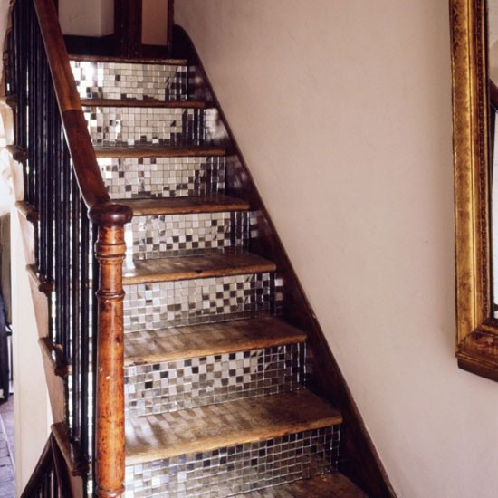 Hallway with mirrored mosaic staircase