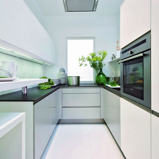 Small Kitchen With Reflective Surfaces