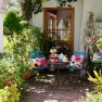 Blue bistro garden dining area | Artist-inspired decorating ideas
