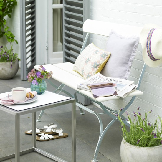 Small garden seating area with metal bench | Outdoor living | Garden | Design | PHOTO GALLERY | Housetohome.co.uk