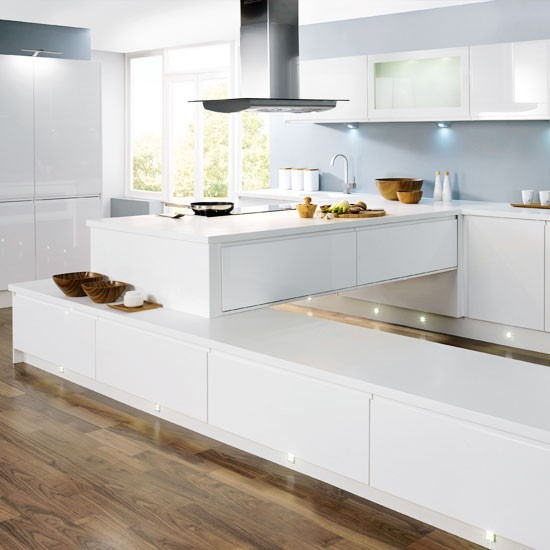 Eye catching lighting in a white kitchen white kitchens for White kitchen wall units