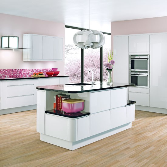 Feminine twist in a white kitchen scheme white kitchens for Beautiful modern white kitchens