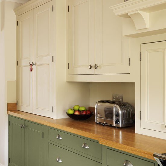 Painted kitchen cabinets green for Cream kitchen cupboards