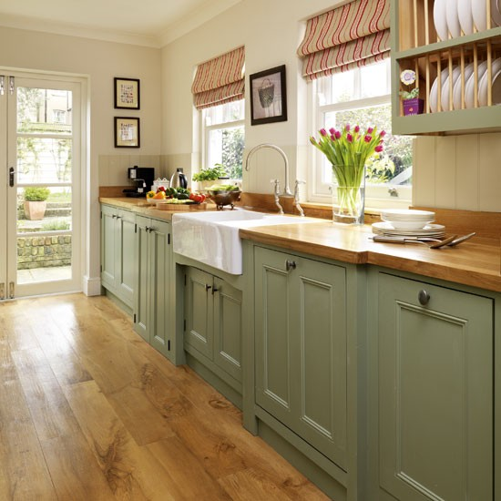 Step inside this traditional muted green kitchen for Green kitchen cabinets