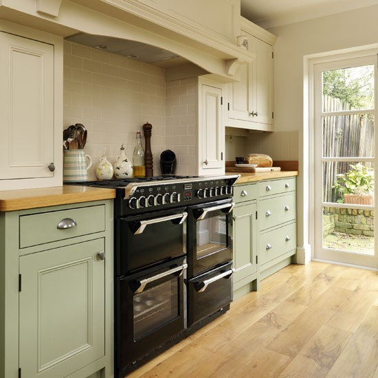 Range cooker step inside this traditional muted green for Green kitchen pictures