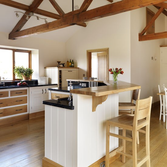 Take a tour around a neutral barn conversion kitchen for Breakfast bar ideas for kitchen