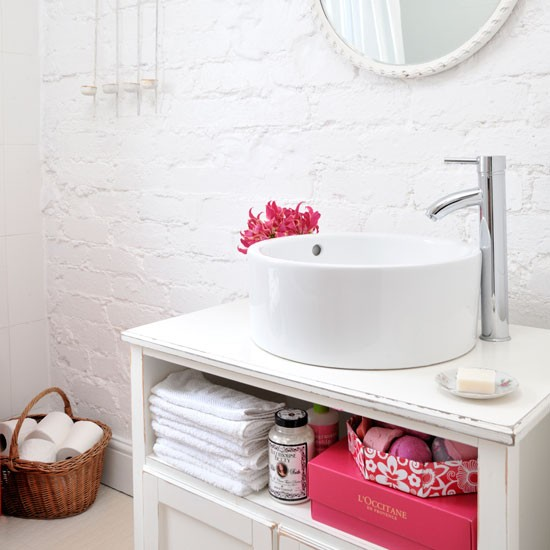Bathroom basin with storage space underneath