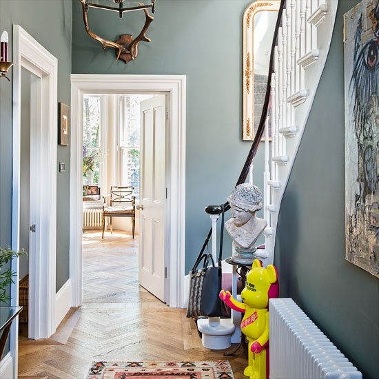 Classic grey hallway with quirky accents Hallway colour scheme ideas