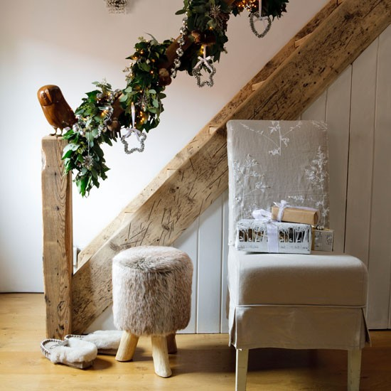 Neutral country hallway with eucalyptus garland