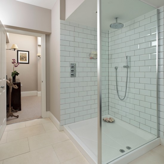 Shower Head Adds A Touch Of Luxury In This Spacious White Shower Room