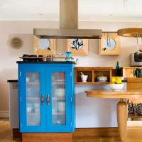 Step inside an eclectic painted and wooden kitchen