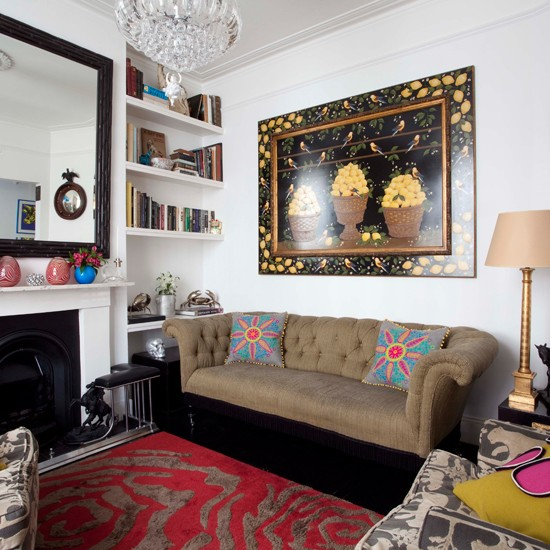 this eclectic living room features unique pieces and contrasting