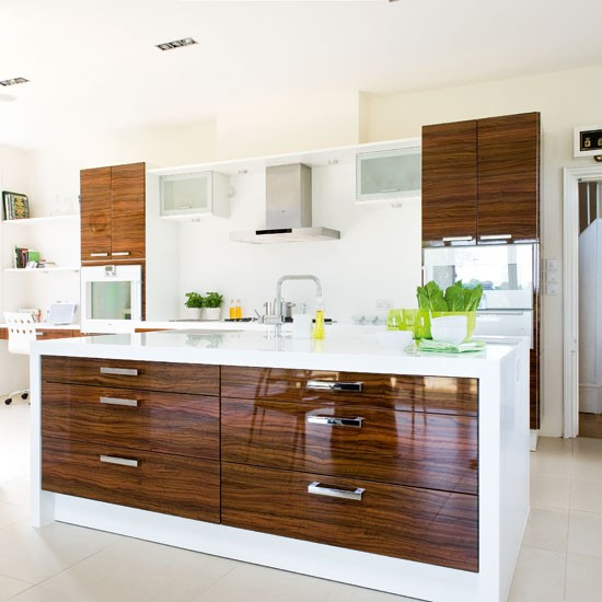 A Dark Wood And White Hi-gloss Kitchen