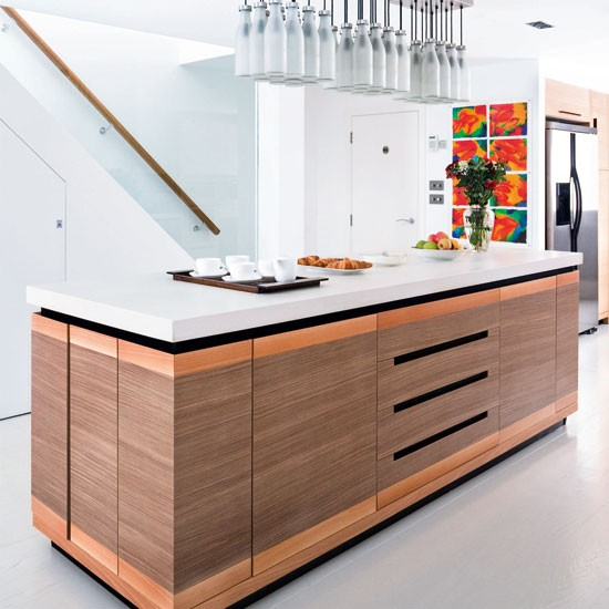 White kitchen with handleless walnut and oak kitchen island, white