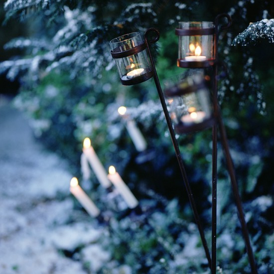Use candles for dickensian charm outdoor christmas for Outdoor christmas candles