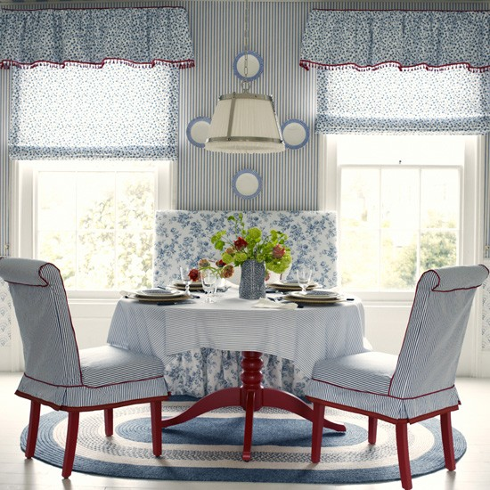 Blue and white dining room with large windows
