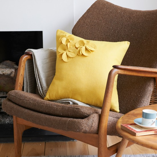Brown fabric chair with yellow cushion