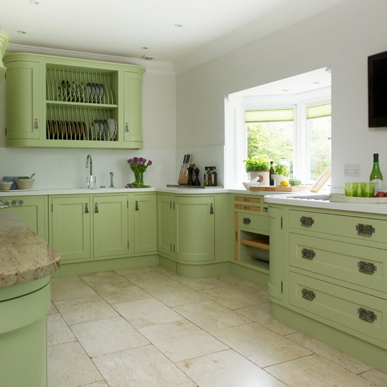Green painted kitchen with storage for Green country kitchen ideas