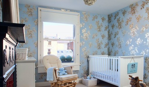 Wallpaper patterned blue wall on the baby bedroom design
