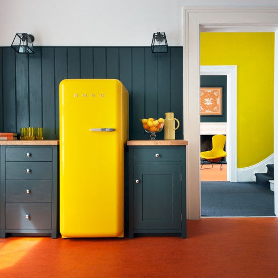 Modern grey kitchen with statement yellow fridge freezer for Yellow and gray kitchen