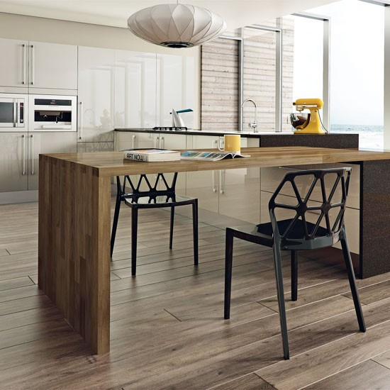 Modern kitchen with island table contemporary kitchen for Kitchen island table with chairs