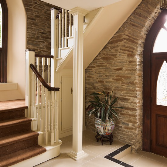 Exposed brick country hallway for Country hallway ideas