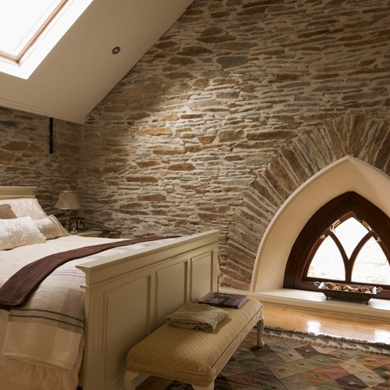 Country bedroom with exposed brick walls Brick wall bedroom design