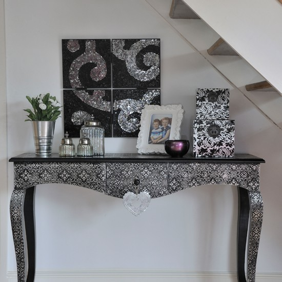 silver console table in hallway