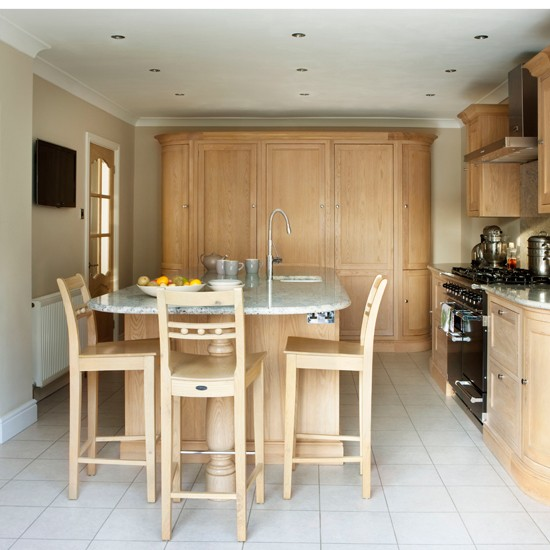 Oak and cream kitchen unit with island unit housetohome for Cream kitchen wall units