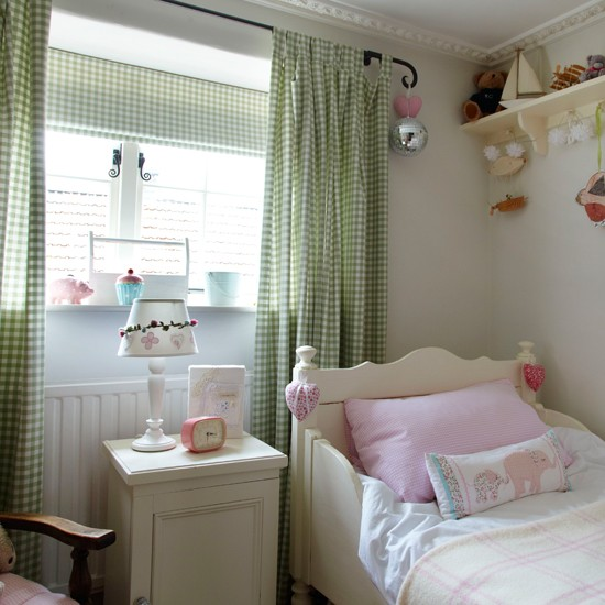 Country-style girl's bedroom with gingham curtains
