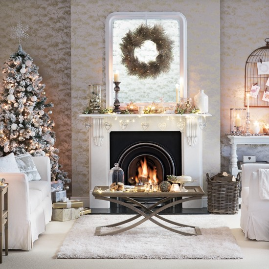white and silver living room with christmas tree