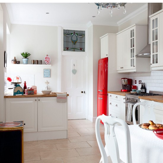 White country kitchen with red accessories | housetohome.co.uk