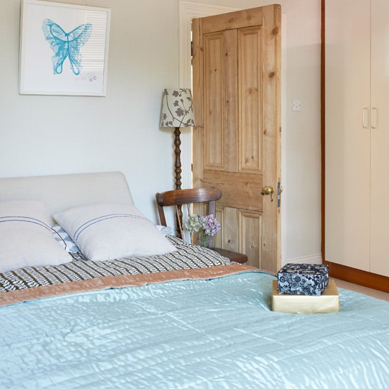Simple Cream Bedroom With Pale Blue Accessories