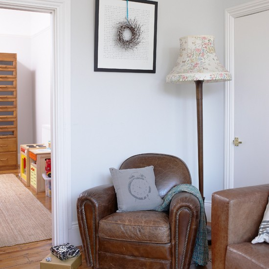 creates a cosy place to read in a corner of this neutral living room