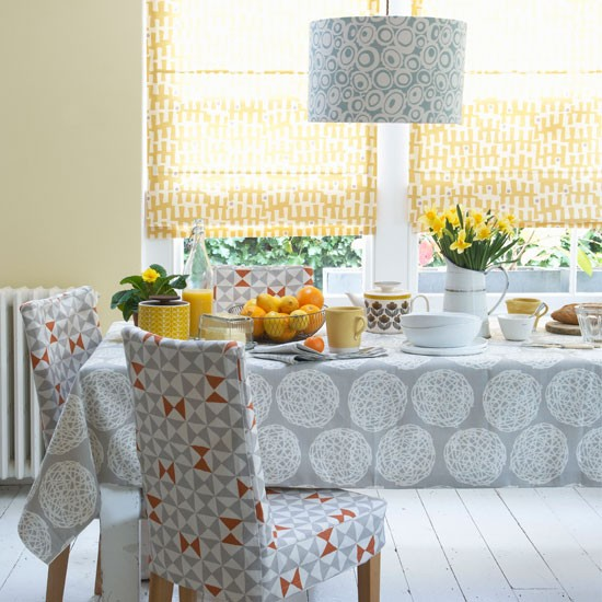 Graphic dining room how to decorate with yellow and for Orange and grey dining room