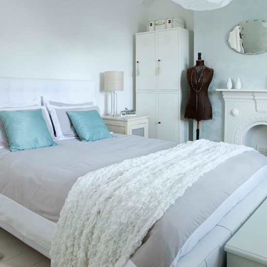 All white bedroom with a hint of colour small bedroom for Blue white and silver bedroom ideas