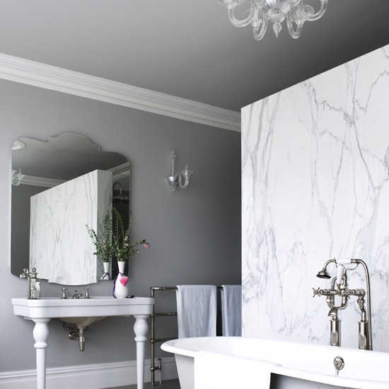 bath washstand and decorative mirror add elegance to this bathroom