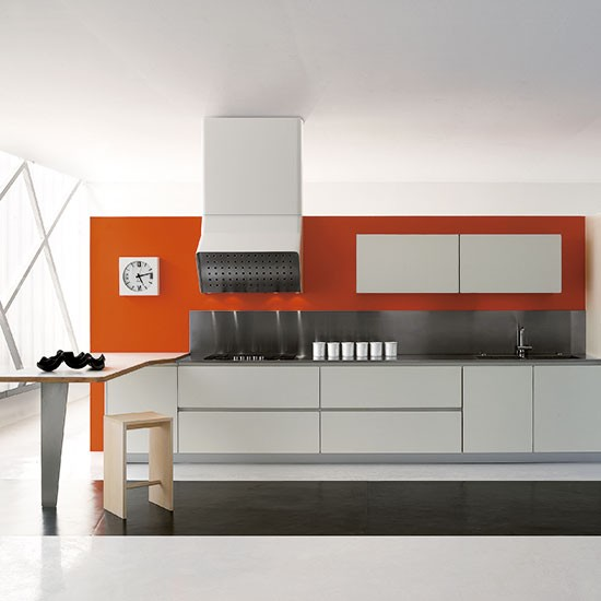 Orange Kitchen Room With White Cabinets Stock Image: Sleek Glossy Galley