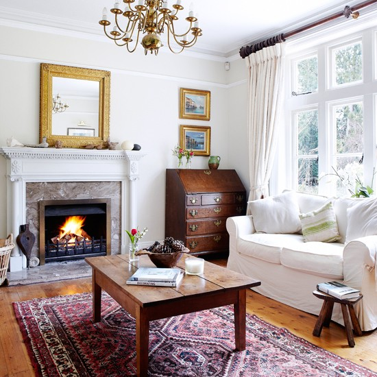 This Country Living Room Is Painted In A Calming Off White Hue While