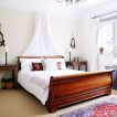 Calming white bedroom with sleigh bed