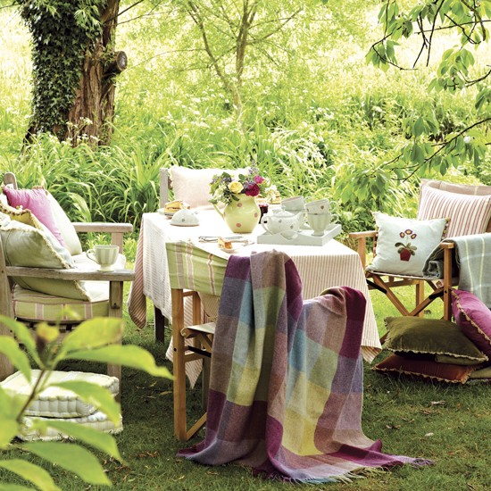 Summer garden with chairs and soft furnishings