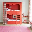 Red and white bedroom with bunk bed