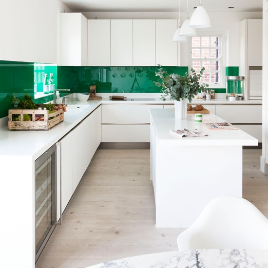 Glossy Green Cabinets Infuse Vitality To This Kitchen: Vibrant Green And White Streamlined Kitchen